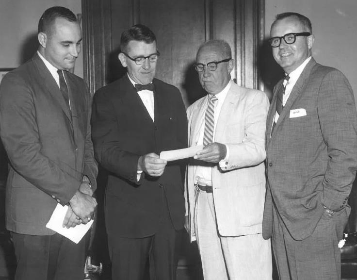 Presenting check for Borda Wing left to right: Ernie Cooke PhD, Judge William Gallogly, Earl W. G. Horward, and Donald Ford.